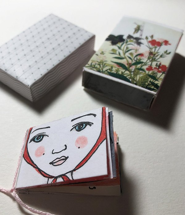 "I made a teeny tiny art journal and decorated a match box to store it in for the prompt on day 27 of the Joyful Art Journaling 30 day challenge, which was ""3-D."" #joyfulartjournaling #artjournalchallenge"